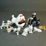 Assortment of 9 Ceramic 1950s Dimestore Dog Figurines